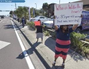 Protesters rally in front of the A&G Restaurant in Winter Haven.